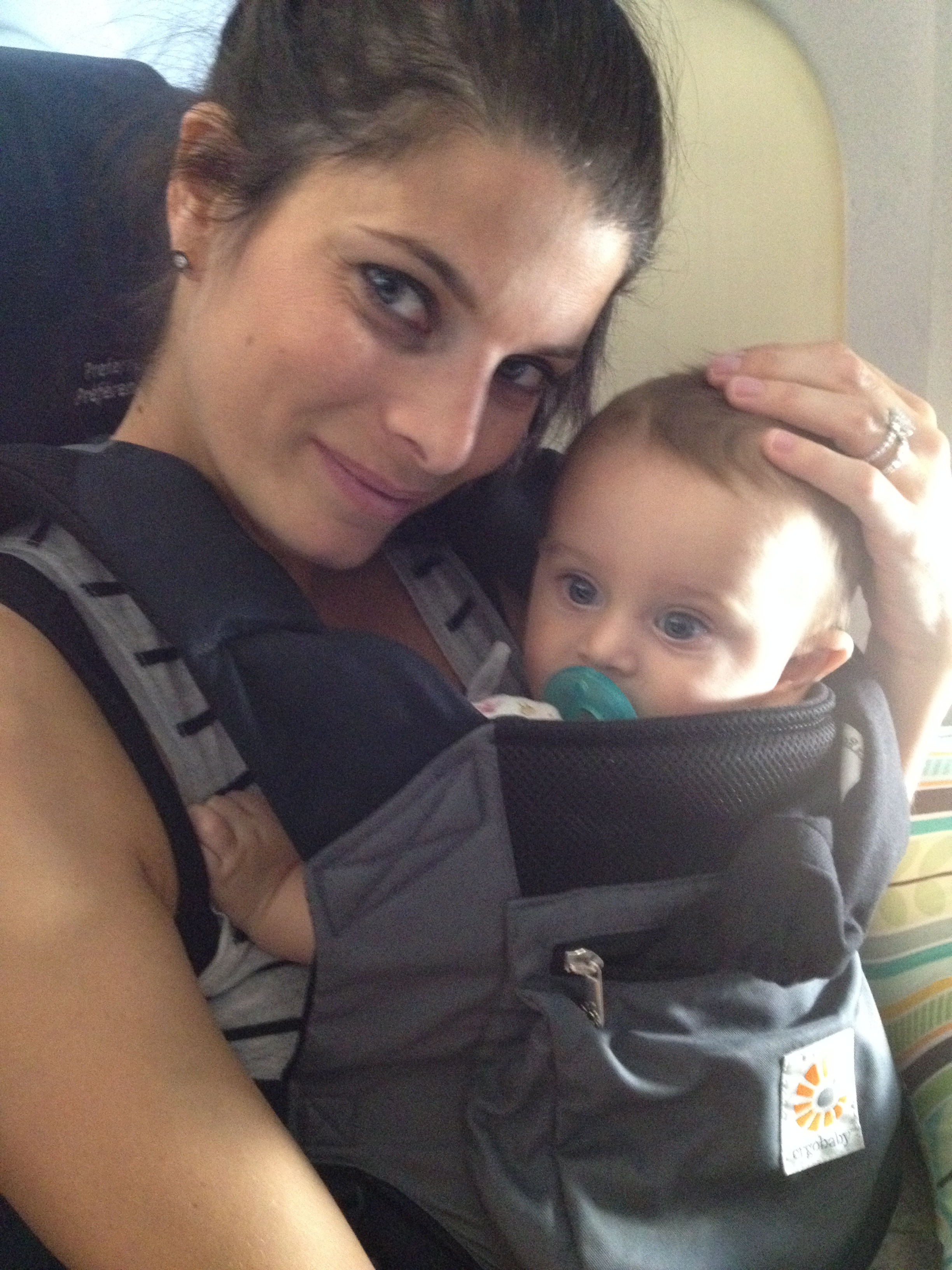Helping Infants Sleep On A Plane Family Travel Guide