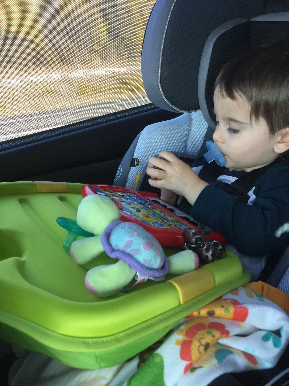 Essentially Its A Lightweight Lap Desk That Clips On To Your Childs Car Seat Transforming Their Area Into Usable Space